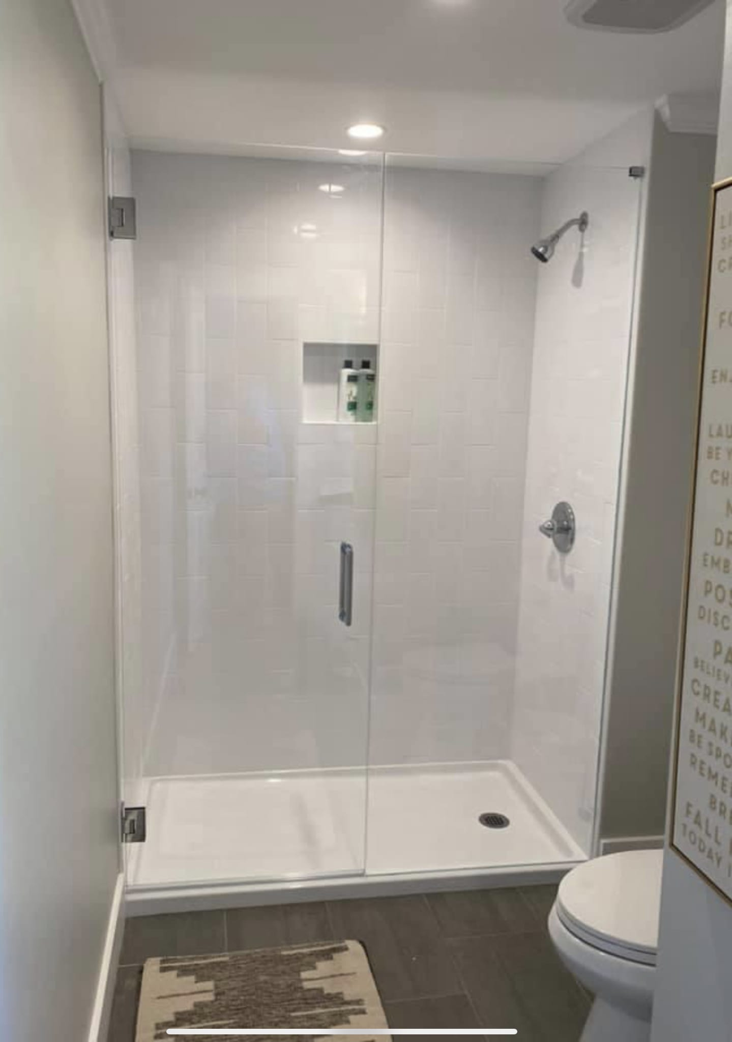 small white shower with custom bathroom mirrors and decorative glass from Shower Doors of Nashville