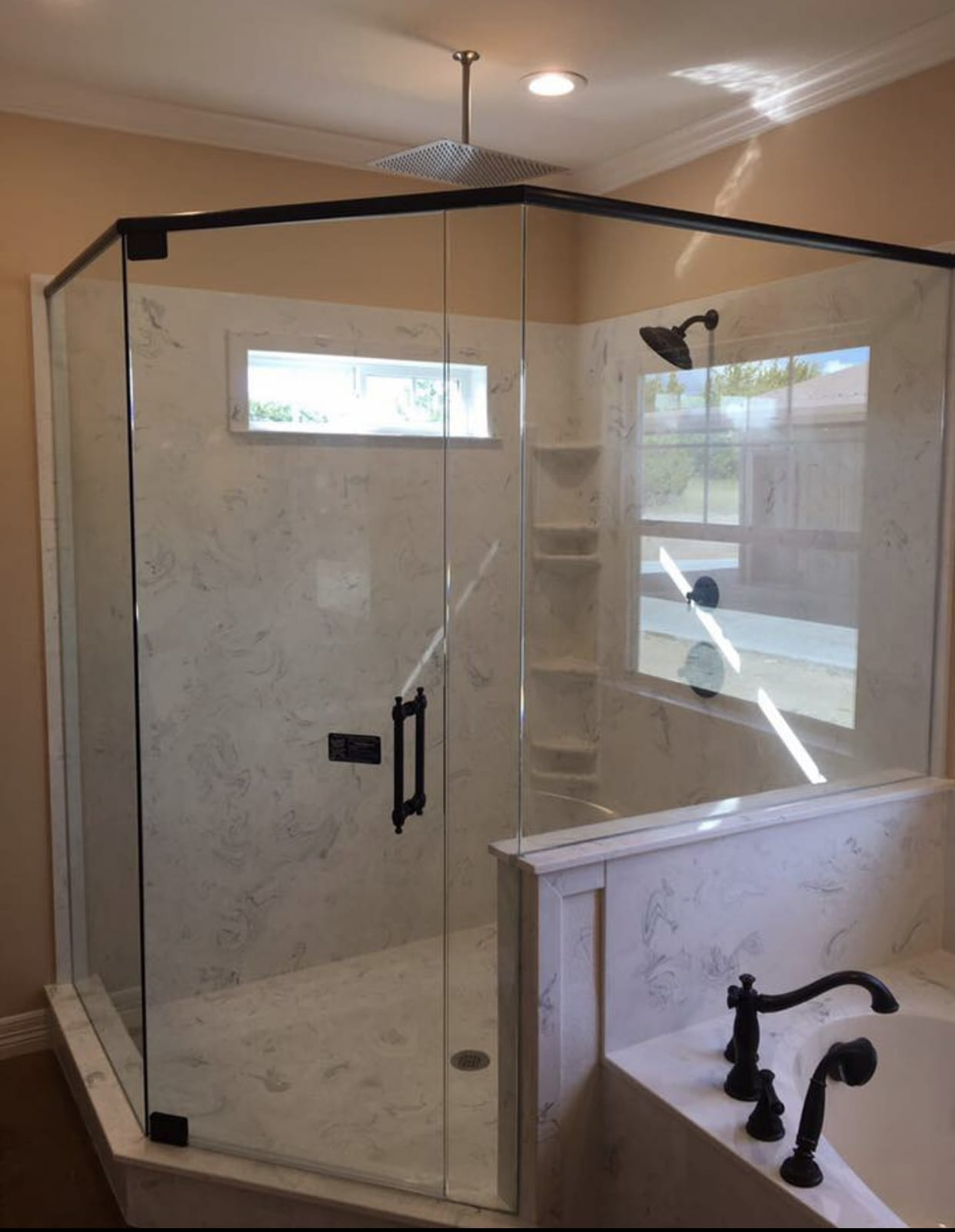 shower in corner with custom bathroom mirrors and decorative glass from Shower Doors of Nashville