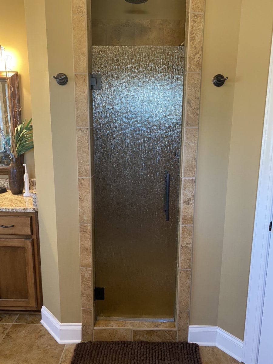 small shower with custom bathroom mirrors and decorative glass from Shower Doors of Nashville