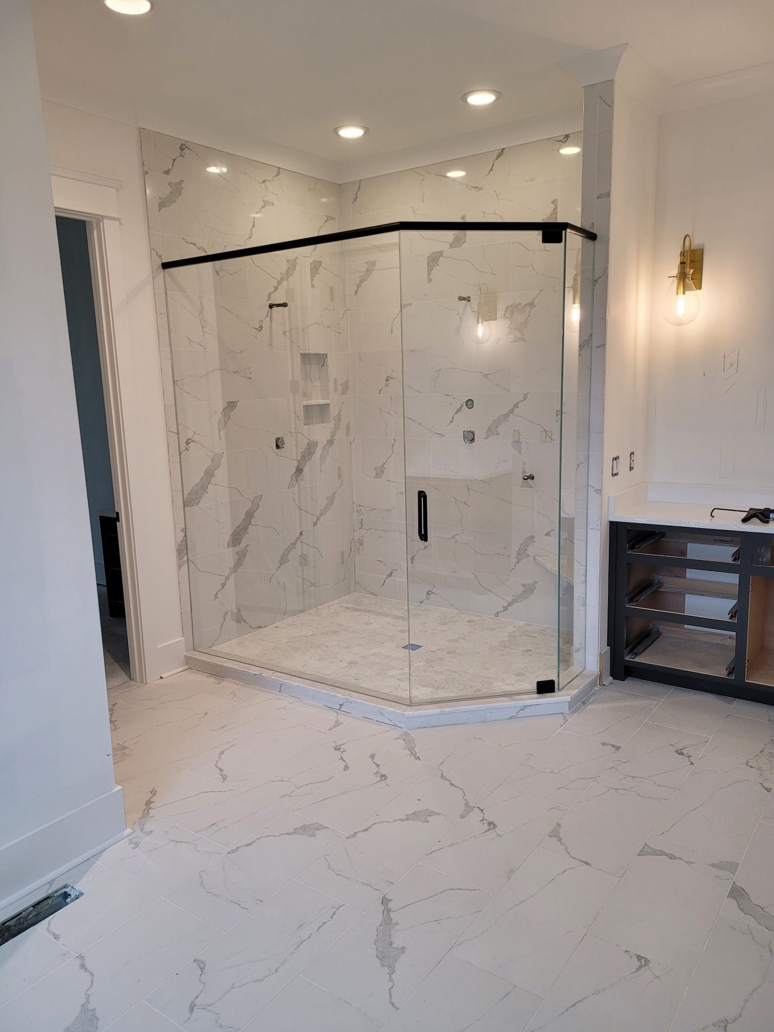 shower installed with custom bathroom mirrors and decorative glass from Shower Doors of Nashville
