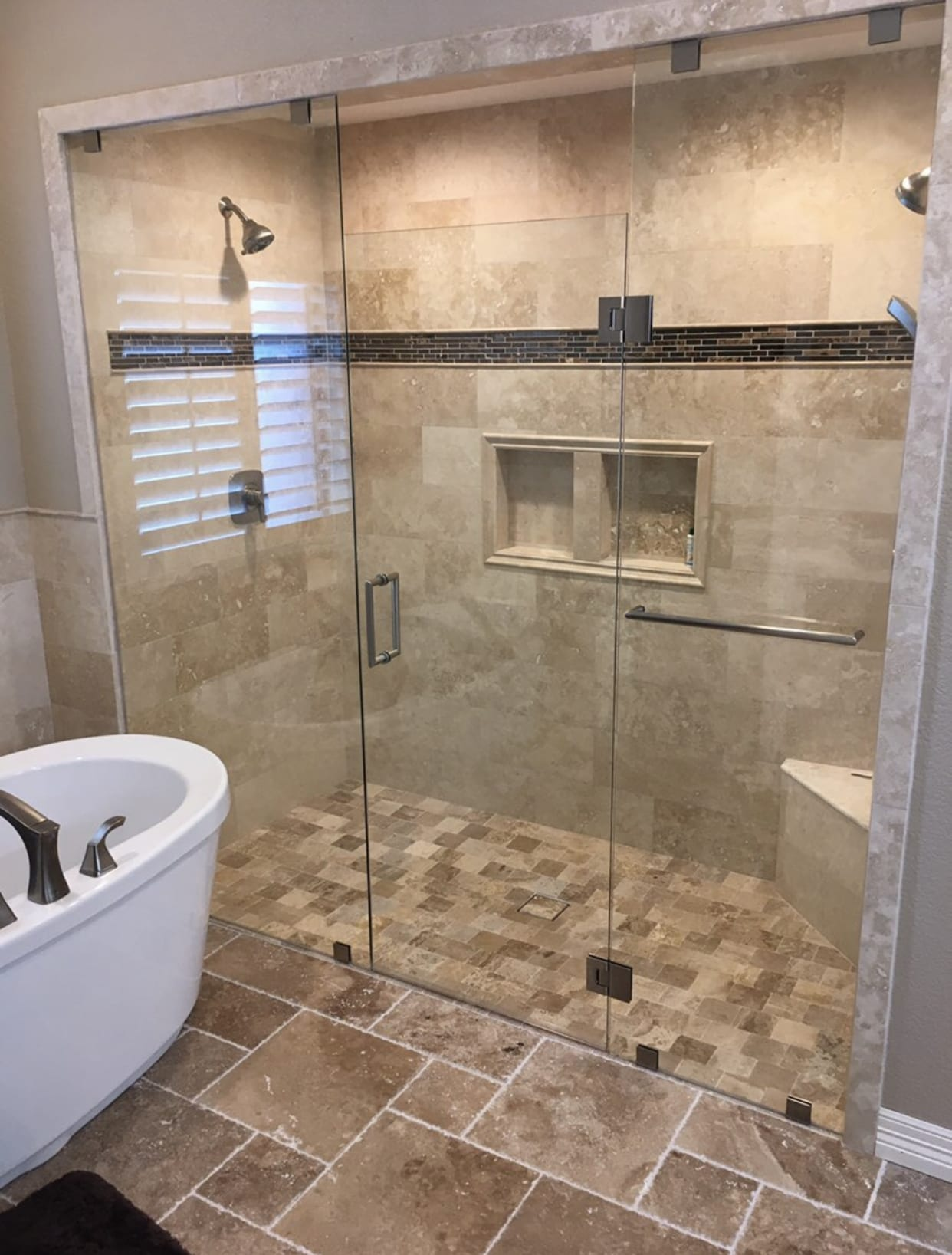 shower enclosure with custom bathroom mirrors and decorative glass from Shower Doors of Nashville