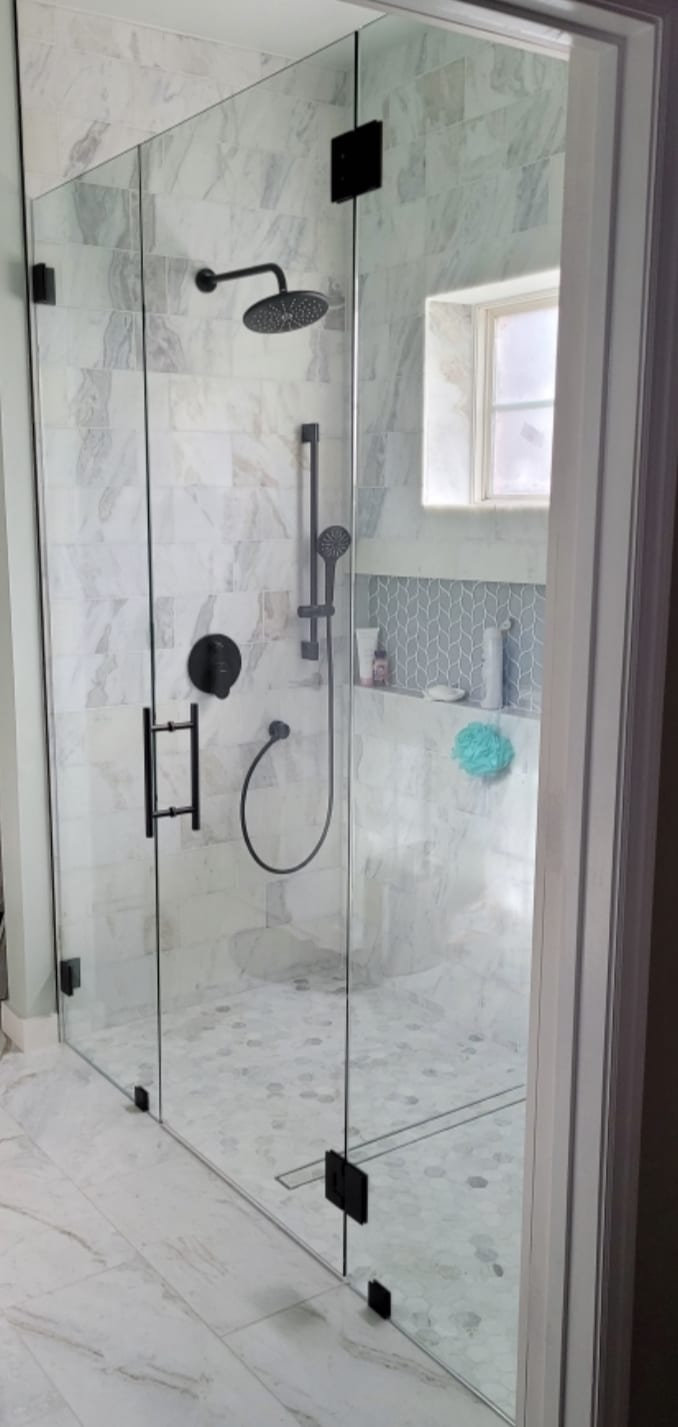 modern shower with custom bathroom mirrors and decorative glass from Shower Doors of Nashville